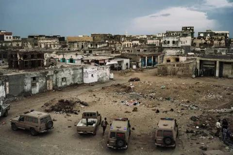 Military vehicles and ambulances are parked in front of a military hospital in Mokha, Yemen.