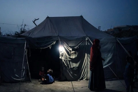 The tent of Salah Galib, 13, lies in a displaced-persons camp. He was hit by a mortar while tending goats.